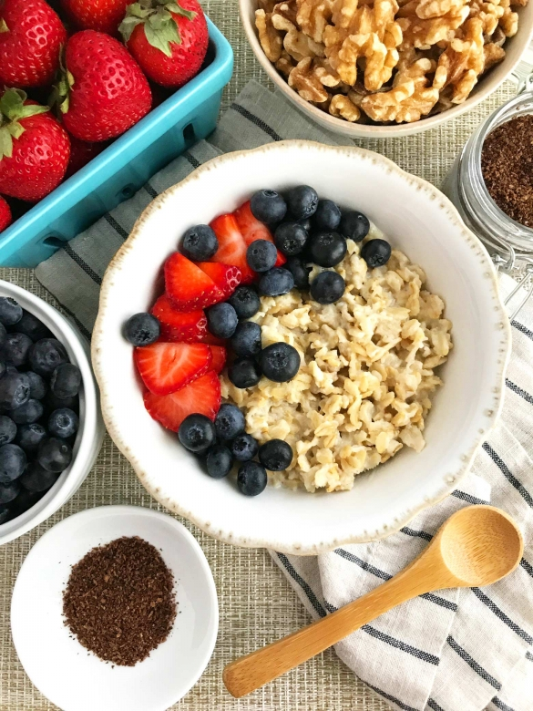 Shows an oatmeal breakfast bowl with fresh fruit