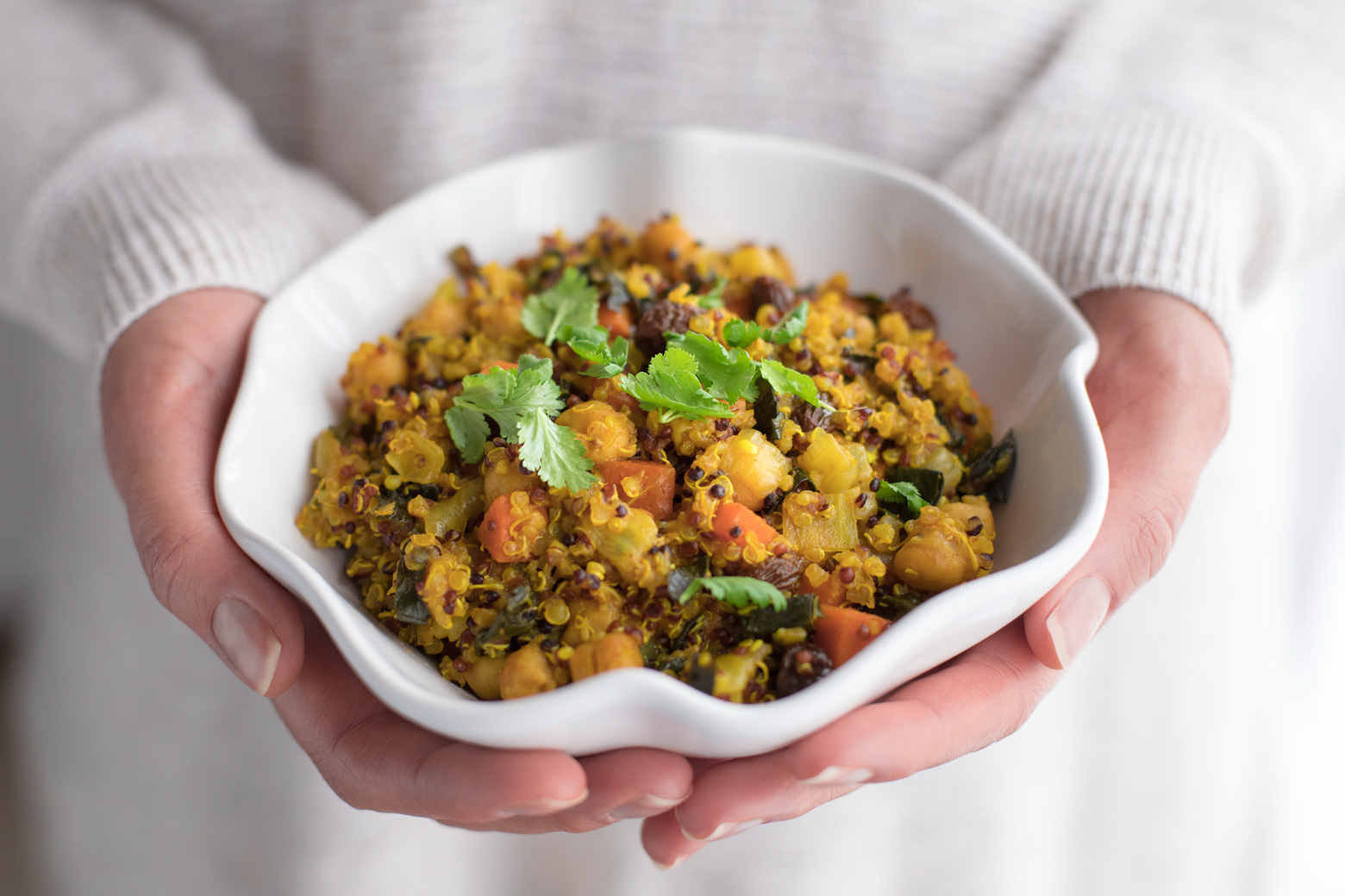 A bowl filled with a chickpea quinoa dish
